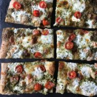 Spinach Pesto Pizza with Smoked Mozzarella & Tomatoes